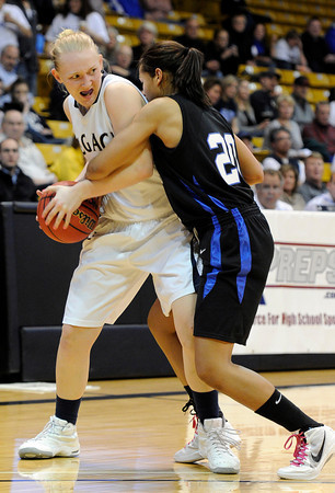 """Legacy High School's Caitlyn Smith fights for the ball with Highland Ranch's Ciera Morgan during a Colorado State Semifinals game against Highlands Ranch High School on Wednesday, March 7,  at the Coors Event Center on the University of Colorado campus in Boulder. Legacy won the game 64-61. For more photos of the game go to  <a href=""""http://www.dailycamera.com"""">http://www.dailycamera.com</a><br /> Jeremy Papasso/ Camera"""