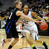 "Legacy High School's Kailey Edwards drives past Highland Ranch's Michaela Neuhaus during a Colorado State Semifinals game against Highlands Ranch High School on Wednesday, March 7,  at the Coors Event Center on the University of Colorado campus in Boulder. Legacy won the game 64-61. For more photos of the game go to  <a href=""http://www.dailycamera.com"">http://www.dailycamera.com</a><br /> Jeremy Papasso/ Camera"