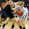 "Legacy High School's Shayna Kuyper drives to the hoop past Highland Ranch's Abriana Lujan during a Colorado State Semifinals game against Highlands Ranch High School on Wednesday, March 7,  at the Coors Event Center on the University of Colorado campus in Boulder. Legacy won the game 64-61. For more photos of the game go to  <a href=""http://www.dailycamera.com"">http://www.dailycamera.com</a><br /> Jeremy Papasso/ Camera"
