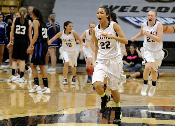 "Legacy High School's Kailey Edwards, front, and the rest of her team celebrate victory during a Colorado State Semifinals game against Highlands Ranch High School on Wednesday, March 7,  at the Coors Event Center on the University of Colorado campus in Boulder. Legacy won the game 64-61. For more photos of the game go to  <a href=""http://www.dailycamera.com"">http://www.dailycamera.com</a><br /> Jeremy Papasso/ Camera"