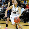 """Legacy High School's Emiley Lopez drives past Highland Ranch's Michaela Neuhaus during a Colorado State Semifinals game against Highlands Ranch High School on Wednesday, March 7,  at the Coors Event Center on the University of Colorado campus in Boulder. Legacy won the game 64-61. For more photos of the game go to  <a href=""""http://www.dailycamera.com"""">http://www.dailycamera.com</a><br /> Jeremy Papasso/ Camera"""