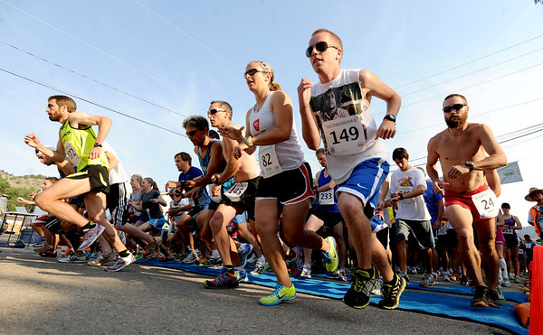 "Runners begin the Lyons River Run 5K on Sunday.<br /> Justin Gindlesperger (172),  far left,  was the winner of the race. Daniel Denton-Weber is #149 on the right.<br /> For more photos of the race, go to  <a href=""http://www.dailycamera.com"">http://www.dailycamera.com</a>. or  <a href=""http://www.timescall.com"">http://www.timescall.com</a>.<br /> Cliff Grassmick / June 24, 2012"