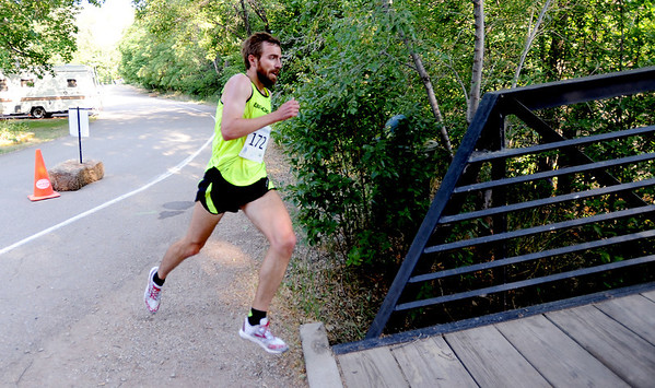 """Justin Gindlesperger   was the winner of the  Lyons River Run 5K on Sunday.<br /> For more photos of the race, go to  <a href=""""http://www.dailycamera.com"""">http://www.dailycamera.com</a>. or  <a href=""""http://www.timescall.com"""">http://www.timescall.com</a>.<br /> Cliff Grassmick / June 24, 2012"""