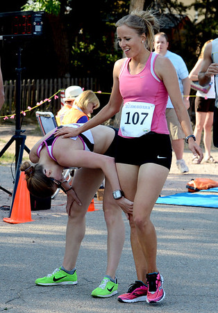 "Ruby Bode (107), who finished second for women, congratulates 5K female winner, Ruth Waller.<br /> For more photos of the race, go to  <a href=""http://www.dailycamera.com"">http://www.dailycamera.com</a>. or  <a href=""http://www.timescall.com"">http://www.timescall.com</a>.<br /> Cliff Grassmick / June 24, 2012"