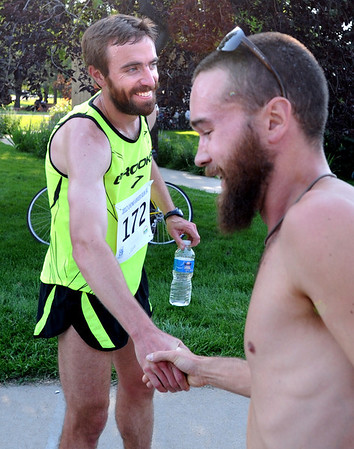 "Justin Gindlesperger, left, winner of the  Lyons River Run 5K, is congratulated by Mike Grady, who finished third on Sunday<br /> For more photos of the race, go to  <a href=""http://www.dailycamera.com"">http://www.dailycamera.com</a>. or  <a href=""http://www.timescall.com"">http://www.timescall.com</a>.<br /> Cliff Grassmick / June 24, 2012"