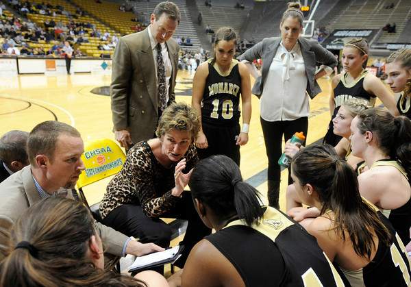 "Monarch High School Head Coach Gail Hook talks with her team during a time-out during a Colorado State Semifinals game against Regis Jesuit High School on Wednesday, March 7,  at the Coors Event Center on the University of Colorado campus in Boulder. Monarch won the game 69-57. For more photos of the game go to  <a href=""http://www.dailycamera.com"">http://www.dailycamera.com</a><br /> Jeremy Papasso/ Camera"