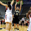 "Monarch High School's Rebecca Richmond takes a shot over Katie Heckman during a Colorado State Semifinals game against Regis Jesuit High School on Wednesday, March 7,  at the Coors Event Center on the University of Colorado campus in Boulder. Monarch won the game 69-57. For more photos of the game go to  <a href=""http://www.dailycamera.com"">http://www.dailycamera.com</a><br /> Jeremy Papasso/ Camera"