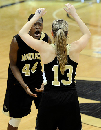 "Monarch High School's Alexus Johnson high-fives Ashton Davis in the final seconds of the Colorado State Semifinals game against Regis Jesuit High School on Wednesday, March 7,  at the Coors Event Center on the University of Colorado campus in Boulder. Monarch won the game 69-57. For more photos of the game go to  <a href=""http://www.dailycamera.com"">http://www.dailycamera.com</a><br /> Jeremy Papasso/ Camera"