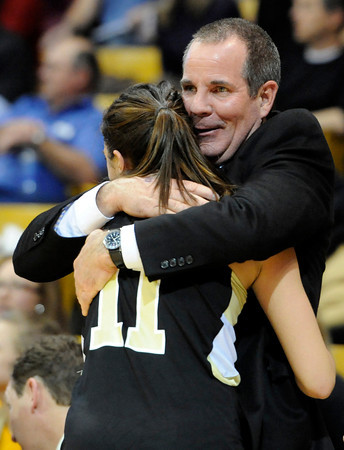 "Monarch High School Assistant Coach John Vidulich hugs Rebecca Richmond in the final seconds of the Colorado State Semifinals game against Regis Jesuit High School on Wednesday, March 7,  at the Coors Event Center on the University of Colorado campus in Boulder. Monarch won the game 69-57. For more photos of the game go to  <a href=""http://www.dailycamera.com"">http://www.dailycamera.com</a><br /> Jeremy Papasso/ Camera"