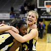 "Monarch High School's Ashton Davis, right, hugs teammates Alexus Johnson and Rebecca Richmond, back, after winning the Colorado State Semifinals game against Regis Jesuit High School on Wednesday, March 7,  at the Coors Event Center on the University of Colorado campus in Boulder. Monarch won the game 69-57. For more photos of the game go to  <a href=""http://www.dailycamera.com"">http://www.dailycamera.com</a><br /> Jeremy Papasso/ Camera"