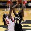 "Monarch High School's Alexus Johnson takes a shot over Diani Akigbogun during a Colorado State Semifinals game against Regis Jesuit High School on Wednesday, March 7,  at the Coors Event Center on the University of Colorado campus in Boulder. Monarch won the game 69-57. For more photos of the game go to  <a href=""http://www.dailycamera.com"">http://www.dailycamera.com</a><br /> Jeremy Papasso/ Camera"