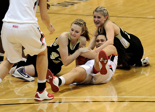 "Monarch High School's Mae Williams, left, and Ashton Davis fight for a loose ball with Regis Jesuit High School's Kelsi Lidge during a Colorado State Semifinals game against Regis Jesuit High School on Wednesday, March 7,  at the Coors Event Center on the University of Colorado campus in Boulder. Monarch won the game 69-57. For more photos of the game go to  <a href=""http://www.dailycamera.com"">http://www.dailycamera.com</a><br /> Jeremy Papasso/ Camera"