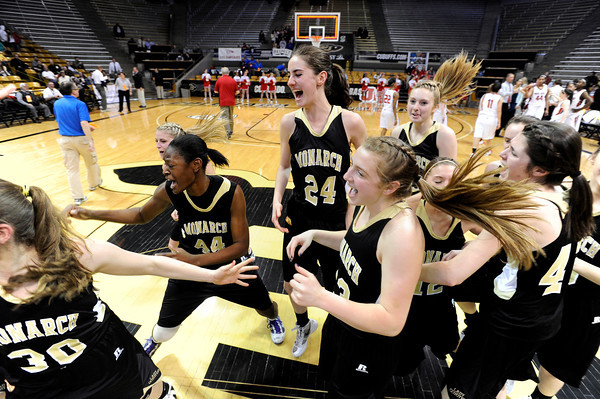 """Monarch High School's Alexus Johnson, No. 44, and Jac Malcolm-Peck, No. 24, celebrate victory with their team during a Colorado State Semifinals game against Regis Jesuit High School on Wednesday, March 7,  at the Coors Event Center on the University of Colorado campus in Boulder. Monarch won the game 69-57. For more photos of the game go to  <a href=""""http://www.dailycamera.com"""">http://www.dailycamera.com</a><br /> Jeremy Papasso/ Camera"""