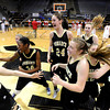 "Monarch High School's Alexus Johnson, No. 44, and Jac Malcolm-Peck, No. 24, celebrate victory with their team during a Colorado State Semifinals game against Regis Jesuit High School on Wednesday, March 7,  at the Coors Event Center on the University of Colorado campus in Boulder. Monarch won the game 69-57. For more photos of the game go to  <a href=""http://www.dailycamera.com"">http://www.dailycamera.com</a><br /> Jeremy Papasso/ Camera"