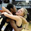 "Monarch High School's Ashton Davis, right, screams while hugging Alexis Johnson, left, and Rebecca Richmond, middle, after defeating Regis Jesuit High School during a Colorado State Semifinals game  on Wednesday, March 7,  at the Coors Event Center on the University of Colorado campus in Boulder. Monarch won the game 69-57. For more photos of the game go to  <a href=""http://www.dailycamera.com"">http://www.dailycamera.com</a><br /> Jeremy Papasso/ Camera"