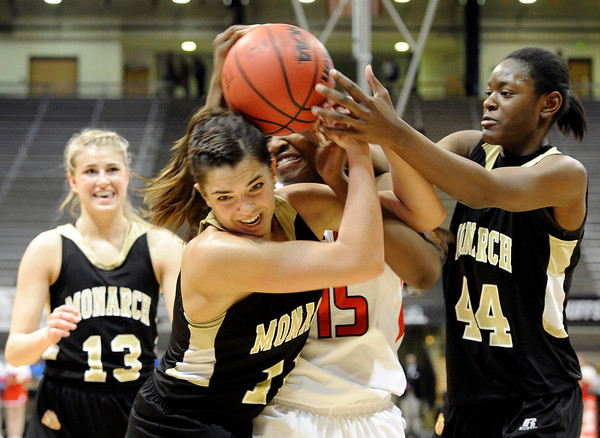 """Monarch High School's Rebecca Richmond fights for the ball with Regis Jesuit High School's Diani Akigbogun and Alexus Johnson, right, during a Colorado State Semifinals game against Regis Jesuit High School on Wednesday, March 7,  at the Coors Event Center on the University of Colorado campus in Boulder. Monarch won the game 69-57. For more photos of the game go to  <a href=""""http://www.dailycamera.com"""">http://www.dailycamera.com</a><br /> Jeremy Papasso/ Camera"""