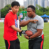 NFL Hall of Fame running back, Barry Sanders, demonstrates how to take a hand-off