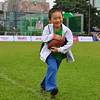 A young clinic participant learns how to take a hand-off at the NFL Experience football skills clinic