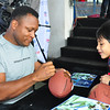 NFL Hall of Fame running back, Barry Sanders, meets a young fan at the NFL Experience in Guangzhou