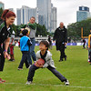 A young clinic participant learns how to catch a football at the NFL Experience football skills clinic