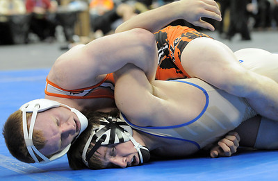 Erie High's Clay Bunker wrestling Broomfield High's Nick Babcock in the 152 lbs 4A championship match during the 2012 State Wrestling Tournament Saturday at the Pepsi Center in Denver. February 18, 2012 staff photo/ David R. Jennings