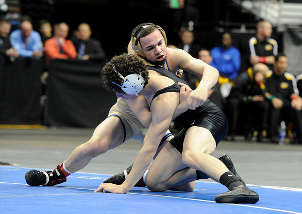 """Broomfield High School's Phil Downing, top, wrestles Roosevelt High School's Jace Lopez during the Class 4A 138-pound championship match on Saturday, Feb. 18, during the 2012 Colorado State Wrestling Championships at the Pepsi Center in Denver. Downing won the match to clench the state title. For more photos of the Championship matches go to  <a href=""""http://www.dailycamera.com"""">http://www.dailycamera.com</a><br /> Jeremy Papasso/ Camera"""