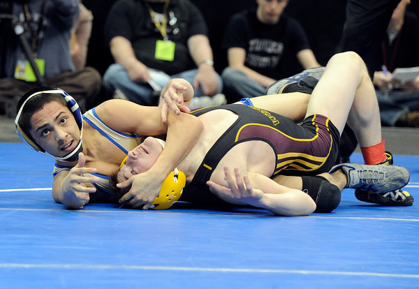 """Broomfield High School's Drew Romero, left, wrestles Windsor High School's Jonathan Lewis on Saturday, Feb. 18, in the Class 4A 106-pound championship match during the 2012 Colorado State Wrestling Championships at the Pepsi Center in Denver. Romero won the match to clench the state title. For more photos of the Championship matches go to  <a href=""""http://www.dailycamera.com"""">http://www.dailycamera.com</a><br /> Jeremy Papasso/ Camera"""