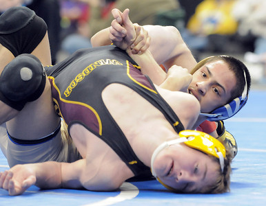 Broomfield High's Drew Romero, above, wrestles Windsor High's Jonathan Lewis in the 106 lbs 4A championship match during the 2012 State Wrestling Tournament Saturday at the Pepsi Center in Denver. February 18, 2012 staff photo/ David R. Jennings