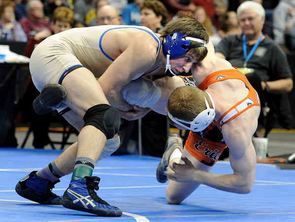 """Broomfield High School's Nick Babcock, left, wrestles Erie High School's Clay Bunker during the Class 4A 152-pound championship match on Saturday, Feb. 18, during the 2012 Colorado State Wrestling Championships at the Pepsi Center in Denver. Babccock won the match to clench the state title. For more photos of the Championship matches go to  <a href=""""http://www.dailycamera.com"""">http://www.dailycamera.com</a><br /> Jeremy Papasso/ Camera"""
