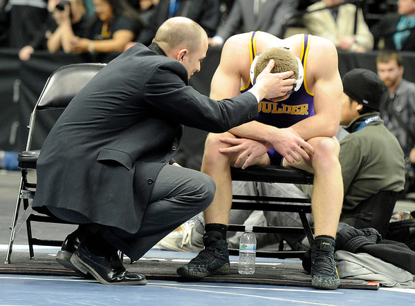 "Boulder High School's Axel Wessell is consoled by his coach after losing to Fountain/ Fort Carson's Josh Schoenberger during the Class 5A 182-pound championship match on Saturday, Feb. 18, during the 2012 Colorado State Wrestling Championships at the Pepsi Center in Denver. Wessell lost the match. For more photos of the Championship matches go to  <a href=""http://www.dailycamera.com"">http://www.dailycamera.com</a><br /> Jeremy Papasso/ Camera"