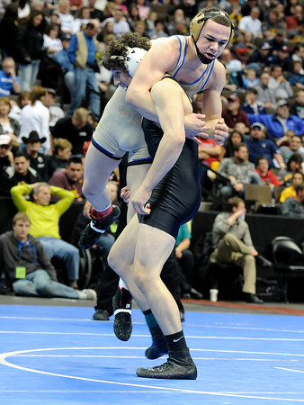 "Broomfield High School's Phil Downing gets lifted off the ground by Roosevelt High School's Jace Lopez during the Class 4A 138-pound championship match on Saturday, Feb. 18, during the 2012 Colorado State Wrestling Championships at the Pepsi Center in Denver. Downing won the match to clench the state title. For more photos of the Championship matches go to  <a href=""http://www.dailycamera.com"">http://www.dailycamera.com</a><br /> Jeremy Papasso/ Camera"