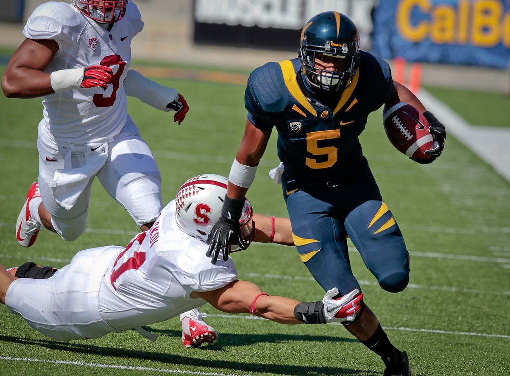 Cal's Brendan Bigelow runs for a 1st down as Stanford's linebacker Shayne Skov tries to tackle him during the Stanford vs. Cal game at Memorial Stadium in Berkeley, Calif.,  on Saturday, Oct.20th, 2012