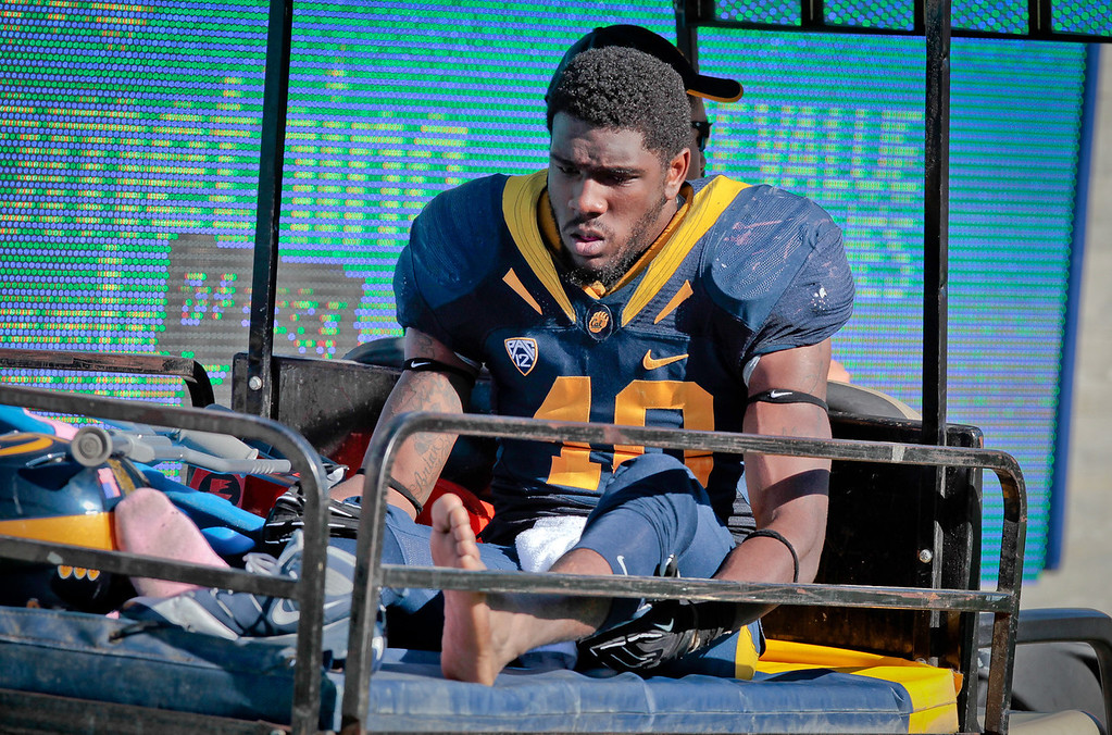 Cal's Steffan Mos comes back on a cart after being injured during th Stanford vs. Cal game at Memorial Stadium in Berkeley, Calif.,  on Saturday, Oct.20th, 2012