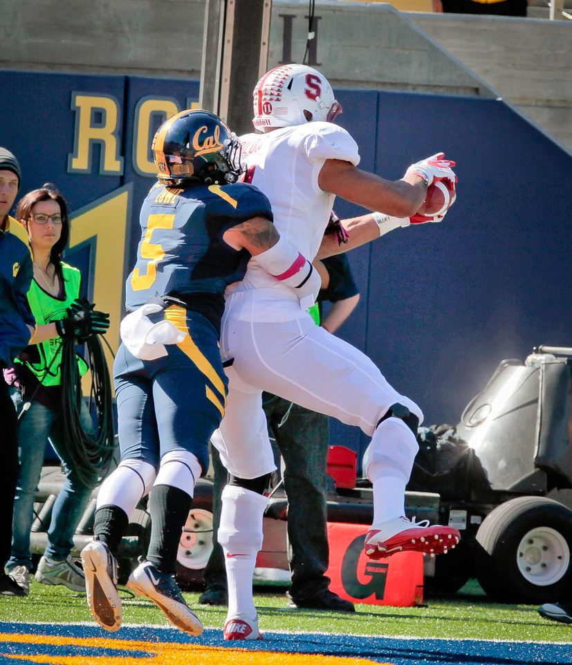Stanford's Levine Toilolo catches touchdown pass as Cal's Michael Lowe defends during the Stanford vs. Cal game at Memorial Stadium in Berkeley, Calif.,  on Saturday, Oct.20th, 2012