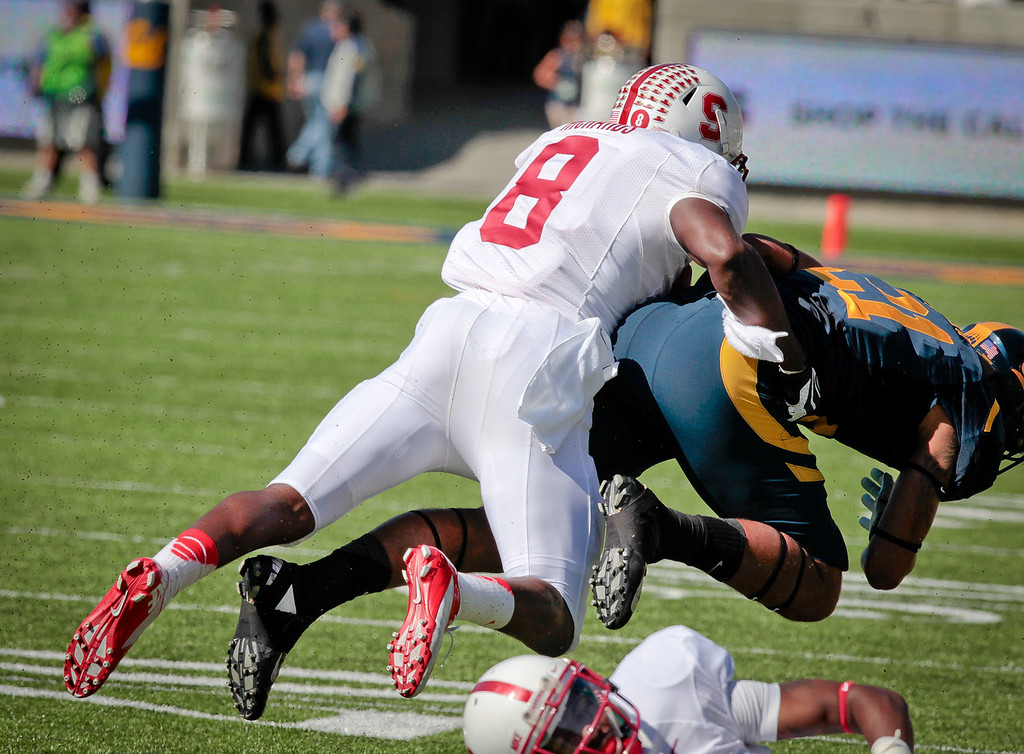 Stanford Jordan Richards forces Cal' Stefan McClure to fumble during the Stanford vs. Cal game at Memorial Stadium in Berkeley, Calif.,  on Saturday, Oct.20th, 2012