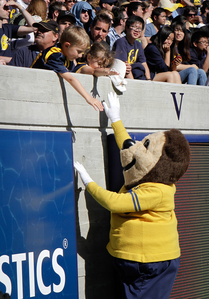 The California Bears mascot Oski high fives kids in the stands during the Stanford vs. Cal game at Memorial Stadium in Berkeley, Calif.,  on Saturday, Oct.20th, 2012