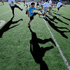 """Zander Hirman, 10, front center, joins other race contestants with warm up exercises before the Sunrise Stampede in Longmont on Saturday.<br /> For more photos and a video of the race, go to  <a href=""""http://www.dailycamera.com"""">http://www.dailycamera.com</a> or timescall.com.<br /> Cliff Grassmick / June 9, 2012"""