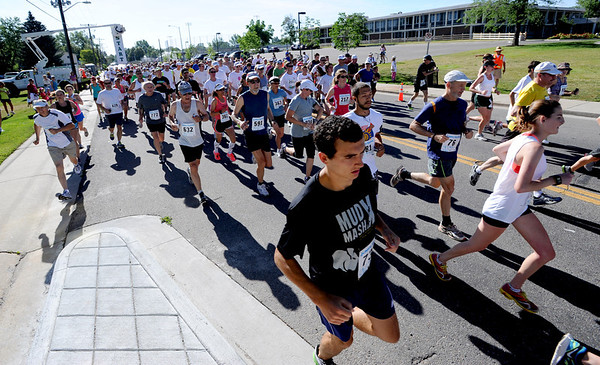 "Hundreds of runners begin the 10K of the Sunrise Stampede in Longmont on Saturday.<br /> For more photos and a video of the race, go to  <a href=""http://www.dailycamera.com"">http://www.dailycamera.com</a> or timescall.com.<br /> Cliff Grassmick / June 9, 2012"