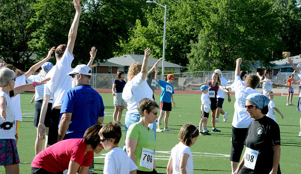 """Runners warm up before the 2012 Sunrise Stampede on Saturday in Longmont.<br /> For more photos and a video of the race, go to  <a href=""""http://www.dailycamera.com"""">http://www.dailycamera.com</a> or timescall.com.<br /> Cliff Grassmick / June 9, 2012"""