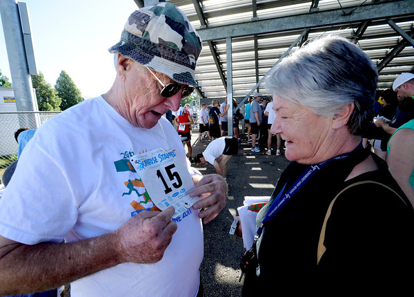 "David Amick, left, gets his race number attached from his wife, Dorothy, before the Sunrise Stampede 2-mile and 10K races.<br /> For more photos and a video of the race, go to  <a href=""http://www.dailycamera.com"">http://www.dailycamera.com</a> or timescall.com.<br /> Cliff Grassmick / June 9, 2012"