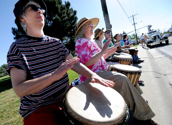 "Cynthia Hardey, left, plays drums with other members of the Front Range Community Djembe Orchestra during the Sunrise Stampede races on Saturday.<br /> For more photos and a video of the race, go to  <a href=""http://www.dailycamera.com"">http://www.dailycamera.com</a> or timescall.com.<br /> Cliff Grassmick / June 9, 2012"