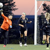 Peak to Peak High School goalkeeper Sarah Martinez throws the ball in past Erika Yost, center, and No. 15, not listed on roster, on Wednesday, July 25, during the girls All-Star soccer game at Shea Stadium in Highlands Ranch.<br /> Jeremy Papasso/ Camera