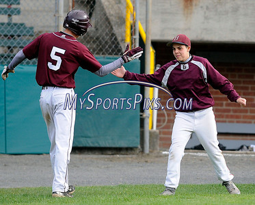 4/27/2012 Mike Orazzi | Staff Bristol Central's Connor Hayes (5) Joey DeFillippi celebrate the third run of the game during Friday's baseball game with Middletown at Muzzy Field in Bristol.