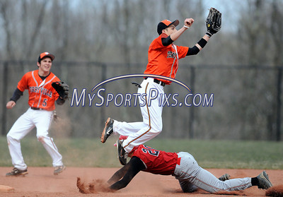 4/10/2012 Mike Orazzi | Staff Terryville's  Kevin Lowell (6) takes the throw as Northwestern's Connor Guiheen (20) slides safely into second base at THS on Tuesday afternoon.