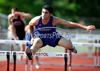5/17/2012 Mike Orazzi | Staff Bristol Eastern's Jean-Claude Mouannes takes first place in the 110 hurdles during Thursday's track meet at BC.