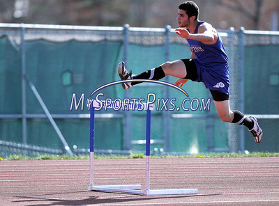 4/13/2012 Mike Orazzi | Staff Bristol Eastern's Jean-Claude Mouannes takes first in the 300 hurdles during  a meet with St. Paul and Kaynor Tech at BEHS on Friday afternoon.
