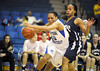 2/11/2012 Mike Orazzi | Staff<br /> CCSU's Danielle Davis (32) and Quinnipiac's Jasmine Martin (24) during Saturday's basketball game in Detrick Gym in New Britain.