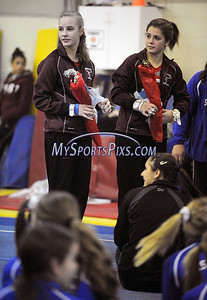 2/15/2012 Mike Orazzi | Staff Bristol Central's Heather Rogan and Kaley Beauchamp during Wednesday night's gymnastics meet at CATS in Cheshire.
