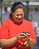 Mama Niu texts the good news of her daughter's first-ever home run.