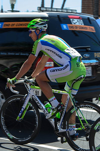 Peter Sagan rides through Sunday morning traffic to get to the start line in Escondido.